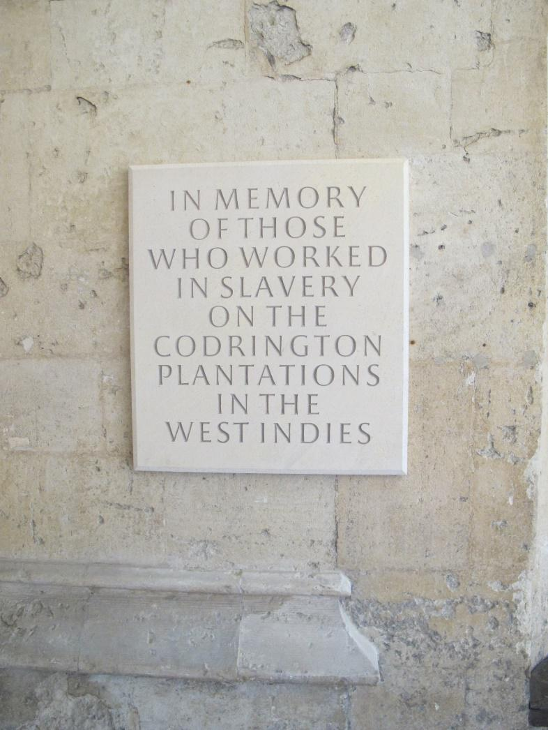 plaque bearing the text 'In memory of those who worked in slavery on the Codrington plantations in the West Indies'